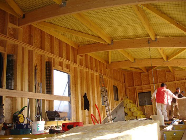 Compte.R. à Arlanc, Puy-de-Dôme, Auvergne ossature bois, charpente courbe lamellé collé
